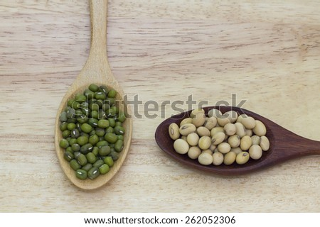 Green beans and soy beans on spoon wood - stock photo