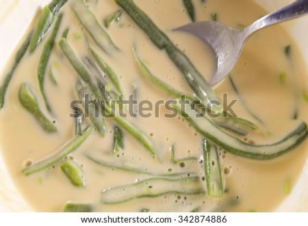 Green Beans in batter mix ready to cook green beans tempura also called peixinhos da horta in Portuguese  - stock photo