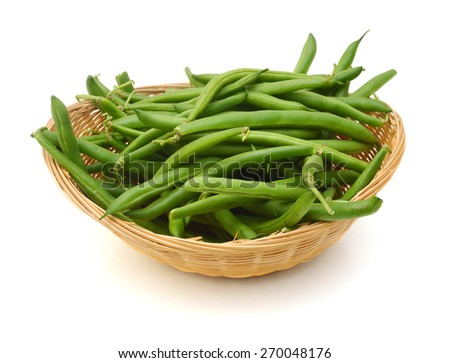 Green beans isolated in basket on a white background. - stock photo