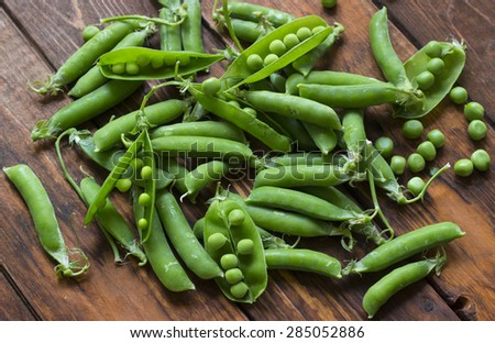 Green beans on a wooden table - stock photo
