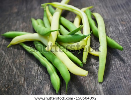 Green beans on the wooden table - stock photo