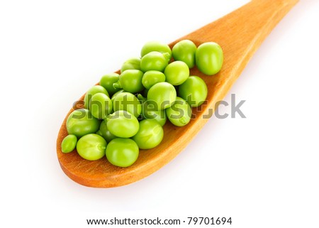 green beans with a wooden spoon isolated on white - stock photo