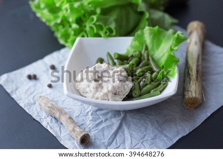 green beans with chicken meatballs with lettuce leaves on a beautiful plate, nutrition, sports nutrition, dinner, lunch - stock photo