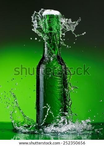 Green beer bottle splash - stock photo