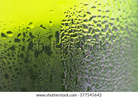 Green beer bottle with water drops./ Green beer - stock photo