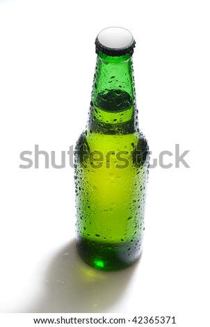 Green beer bottle with water drops isolated on white - stock photo