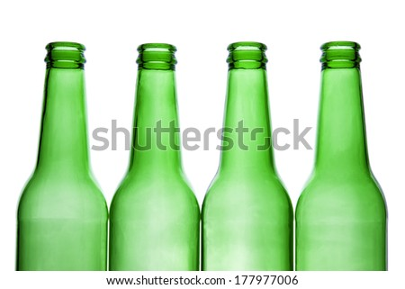 Green beer bottles in a row isolated on white