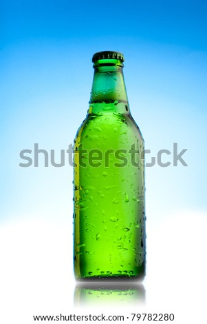 Green beer bottles isolate on blue background