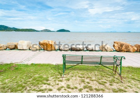 green Bench looking out to the sea on coast of phuket island, Thailand - stock photo