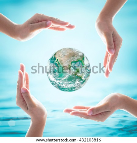 Green big earth among women hands on turquoise blue water background: World ocean & environment protection day concept: Saving CSR BIO healthy earth planet: Element of the image furnished by NASA  - stock photo