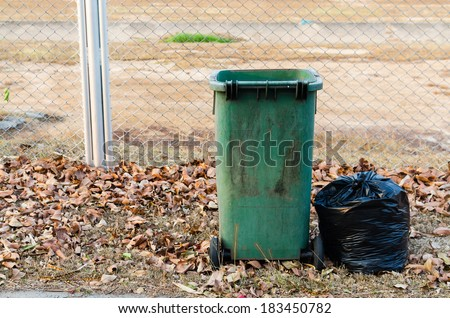 Green bin , Black garbage bags , garbage bags and trashcan , Trash fence - stock photo