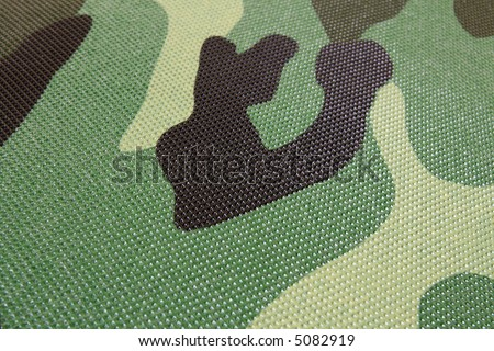 green, black, grey, brown, yellow -  abstract camouflage pattern - stock photo