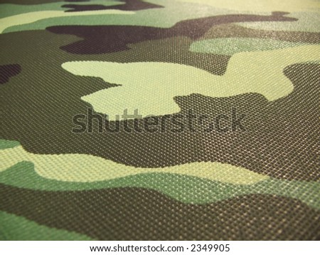green, black, grey, brown, yellow camouflage pattern - stock photo