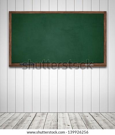 Green blackboard in classroom template - stock photo