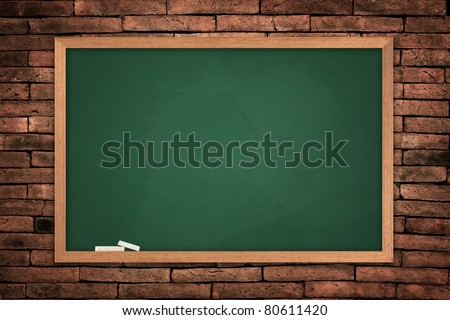Green blackboard on old wall background - stock photo