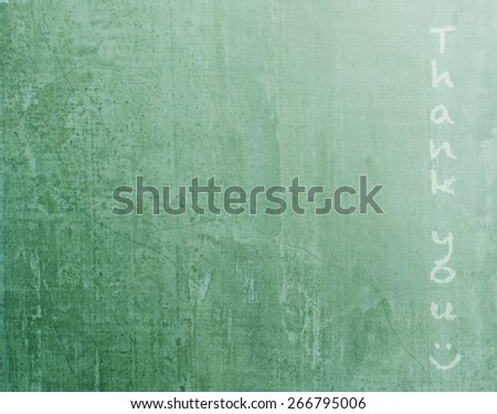 """Green blackboard texture background with vertical text """" Thank you """" and smiley face  (light source from upper right hand corner  - stock photo"""