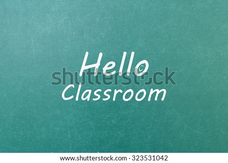 Green blackboard with hand written words note  Hello Classroom - stock photo
