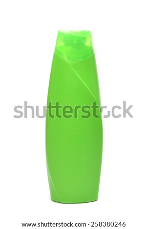 Green blank shampoo container isolated on white background. - stock photo
