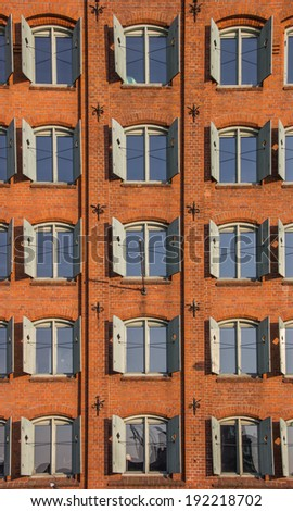 Green blinds on an old storehouse in Lubeck, Germany - stock photo