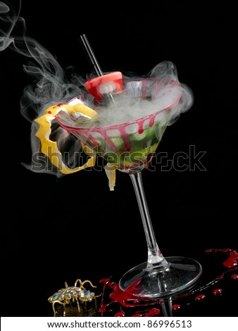 Green bloody cocktail with smoke - stock photo