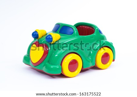 Green, blue and yellow toy car - stock photo