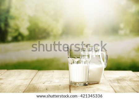 green blurred background and desk space and milk place  - stock photo