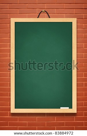 Green board on brown wall background - stock photo
