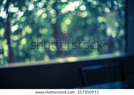 Green bokeh from tree at window - Vintage effect style picture - stock photo