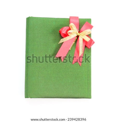 Green book cover with red ribbon isolated on white background  - stock photo