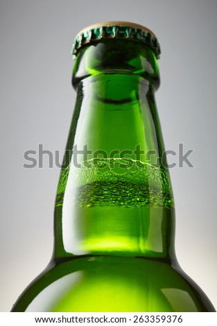 Green bottle of beer close-up - stock photo