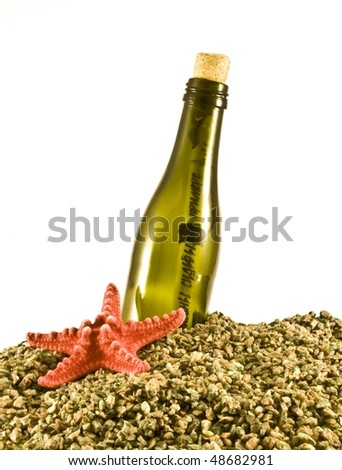green bottle with a message inside. - stock photo