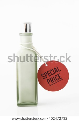 Green bottle with special price tag