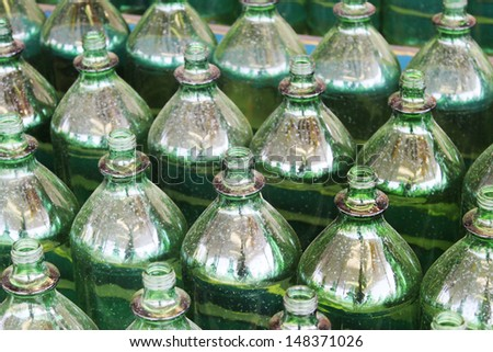 Green bottles in rows - stock photo