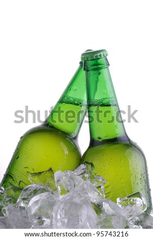 green bottles of beer chilling on ice - stock photo