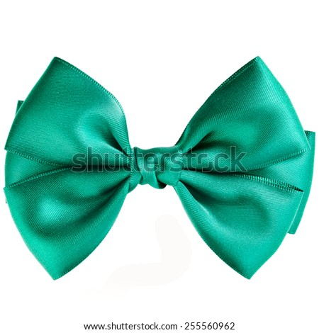 Green bow close up on white isolated on white background - stock photo