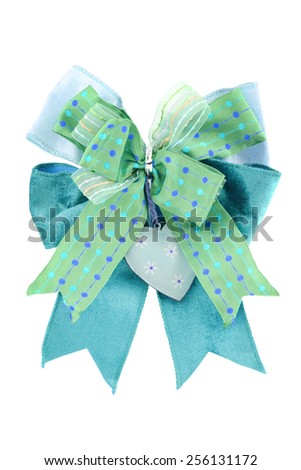 green bow tie with heart white polka flower on an isolated white background - stock photo