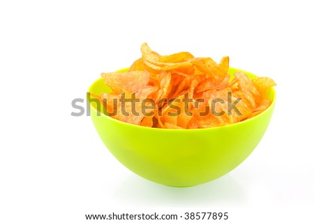 Green bowl with paprika chips isolated on white background - stock photo