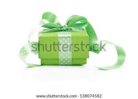 Green box tied with a ribbon with a gift - stock photo