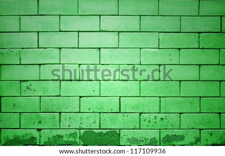 green brick wall getting older from the bottom - stock photo