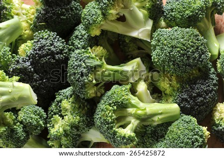 green broccoli on wood table - stock photo