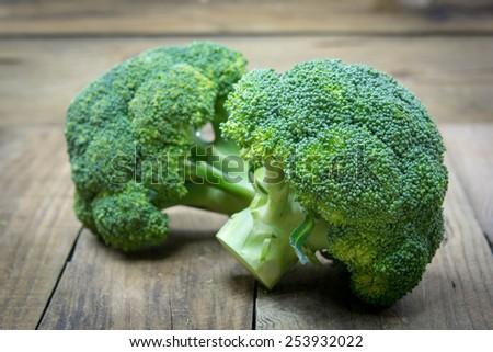 green broccoli on wooden - stock photo