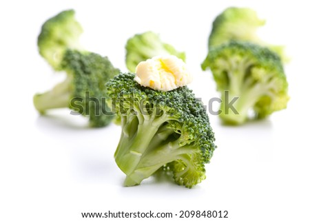 Green broccoli with butter as a garnish - stock photo