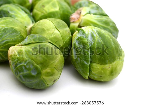 green brussel sprouts on white background  - stock photo