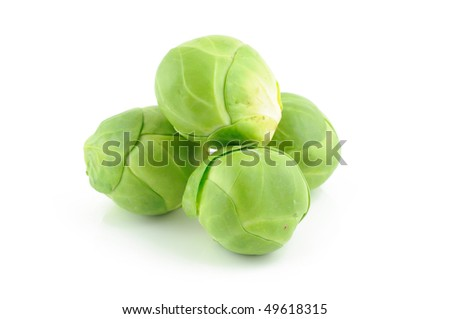 Green brussels sprouts isolated on white background - stock photo