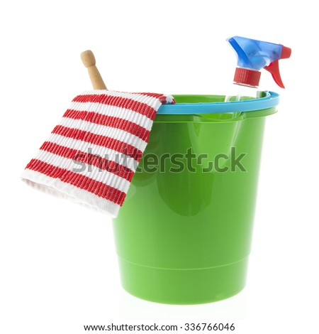 Green bucket with cleaning equipment isolated over white background - stock photo