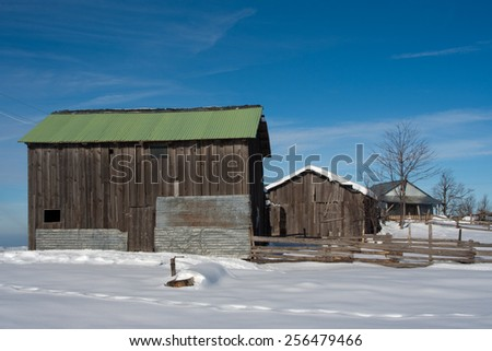 Green Cabin. Open sky with snow at plateau. - stock photo