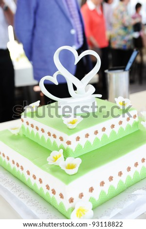 green cake for a wedding with a heart - stock photo