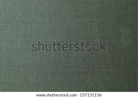 Green canvas texture or background - stock photo