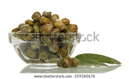 Green capers in glass bowl on white background - stock photo