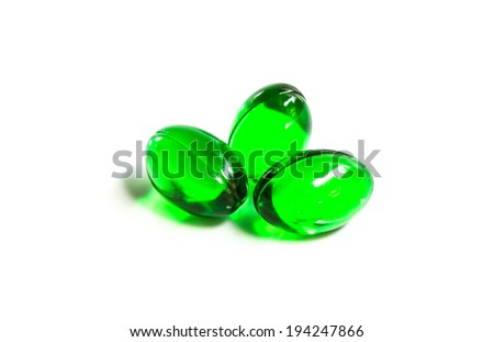 green capsules isolated on white background - stock photo